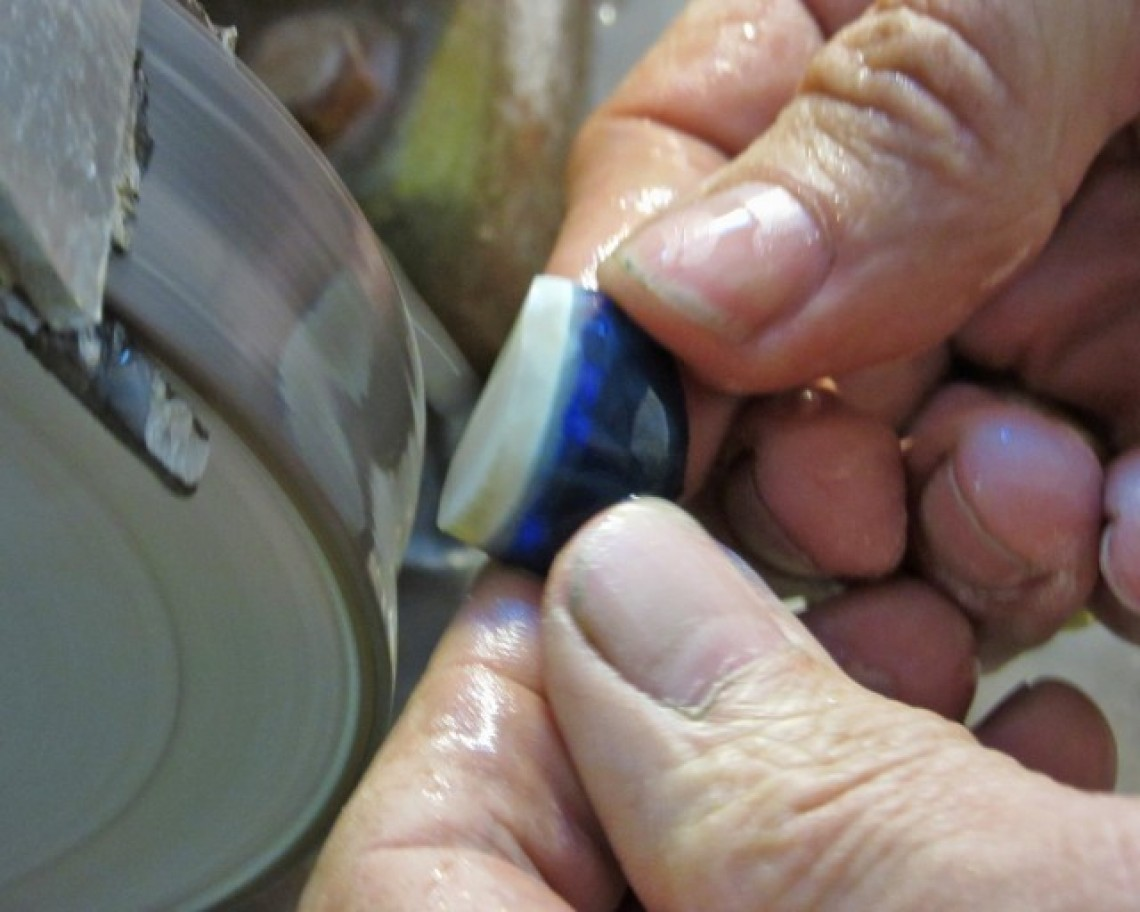 cutting a black opal