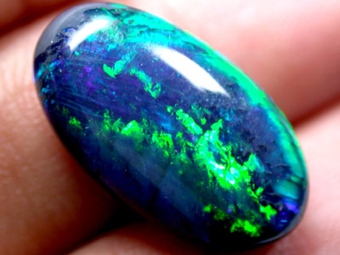 Black opal with Chinese characters that represent Bless