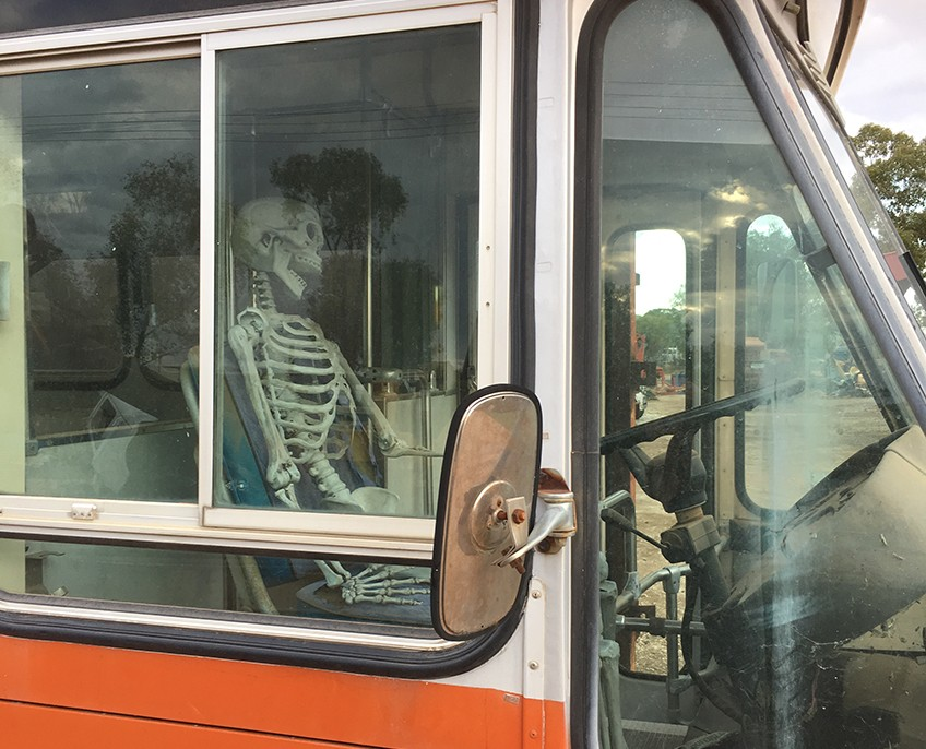 Skeleton bus driver Lightning Ridge town character