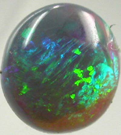 TWO SIDED GREEN STONE[SB6]  .35CTS