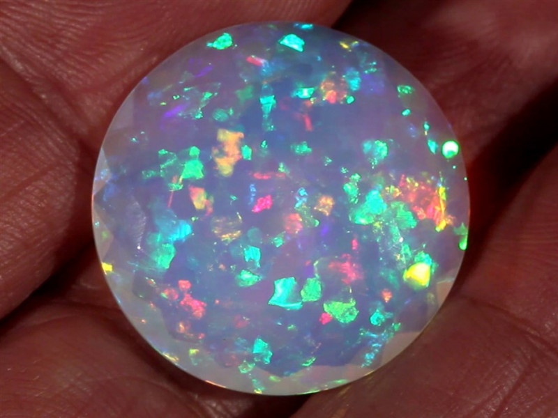 19.95CT COLLECTORS DOUBLE SIDED FACETED ETHIOPIAN WELO OPAL WITH NEON FIRE