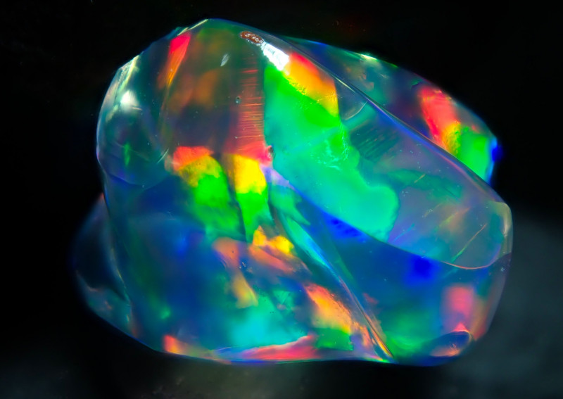 1.56ct Water Opal With Play Of Colour Bright Carved