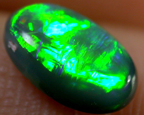 STUNNING GREEN FIRE ON RED FLASH BLACK OPAL 1 CTS  R1639