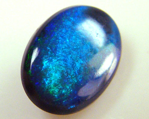 BLACK OPAL IDEAL RING STONE GREEN HUES   .55 CTS   QO 2435