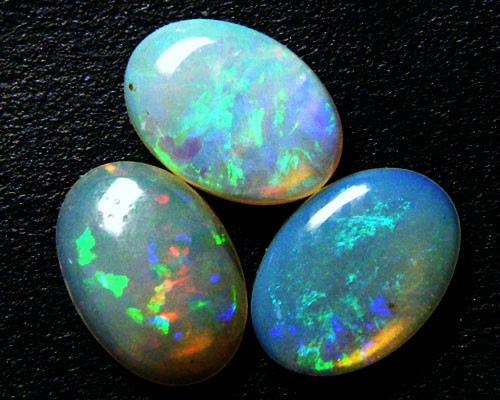 PARCEL THREE BRIGHT CCRYSTAL OPALS    1.45 CARATS  MY280