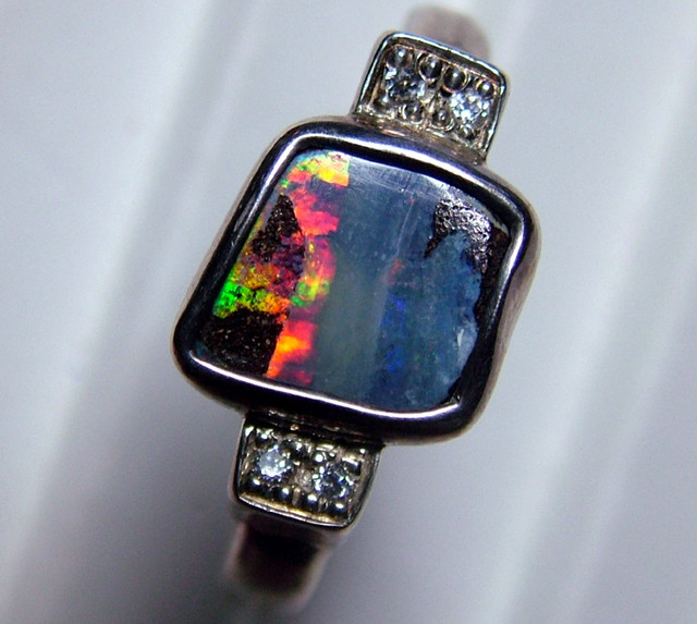 31 CTS BOULDER OPAL MENS RING SIZE145 STERLING SILVER