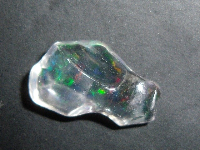 FreeForm carved Fire Mexican Opal 1.22 Carats.