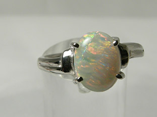 18CT WHITE GOLD OPAL RING - 3.90 grams - #OA710977