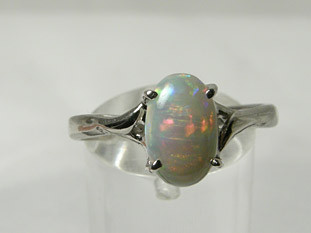 BROAD FLASH 18CT WHITE GOLD OPAL RING - 3.40g - #OA710978