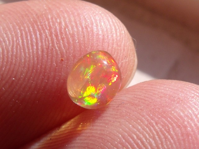 Cabochon flash Mexican Fire Opal 0.71 Carats.