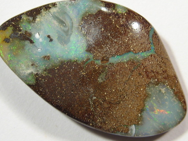 TWO DISTINCT PATCH`S OF GREEN/BLUE OPAL