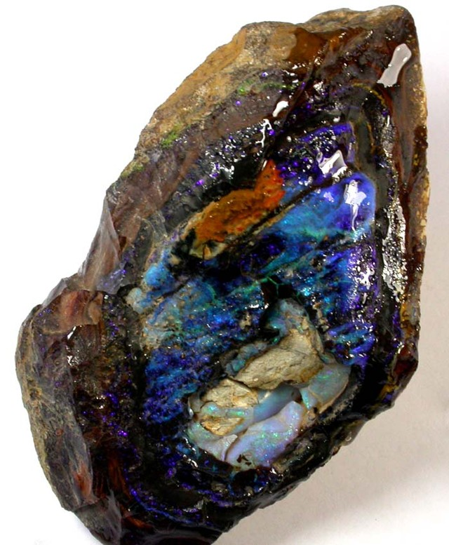 Thge opal is a firey rich dark colour with the centr colour lighter