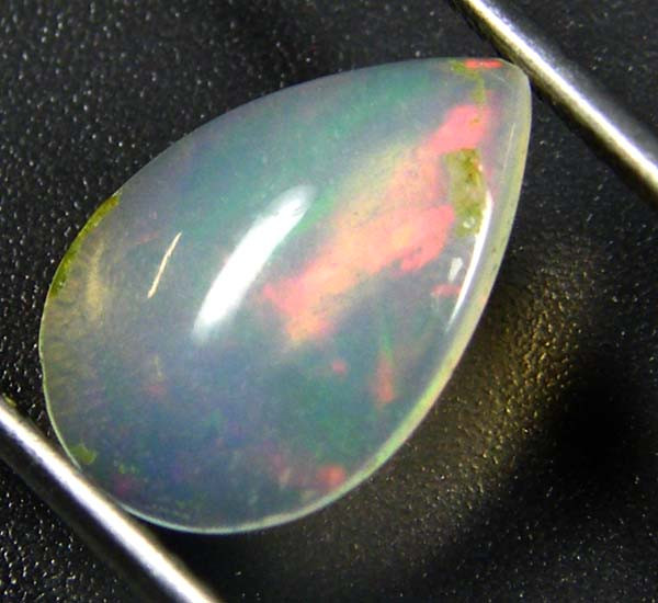 RED ROLLING FIRE ETHIOPIAN OPAL 0.85 CTS  FOB  29