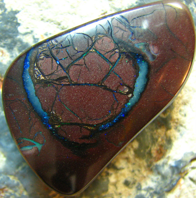 FIREY VEINS BOULDER OPAL DRILLED FOR PENDANT USE 66.50 CT A6785