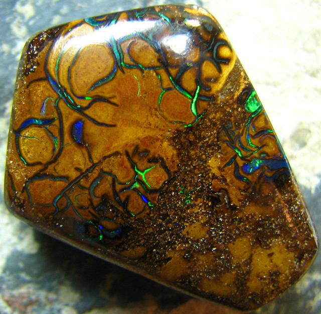 TOP SHAPE PIECE WITH ELECTRIC VAINS  KOROIT OPAL 38.05 CTS