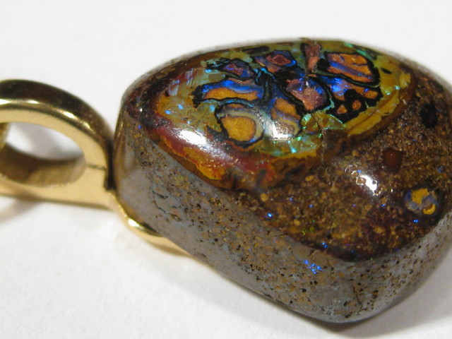 Beautiful Patterns Boulder opal with beaver tail bail setting and 18 inch Gold Fill chain.