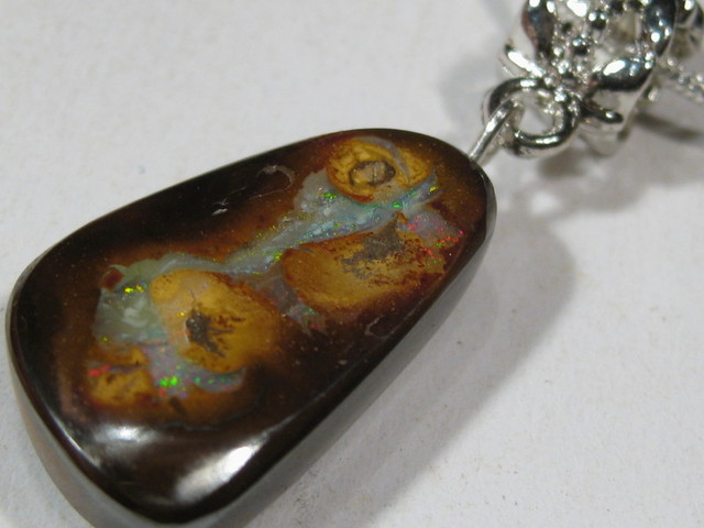 Lovely Boulder Opal Pendant with Quality silver Bail and 18 inch .925 Silver Chain.