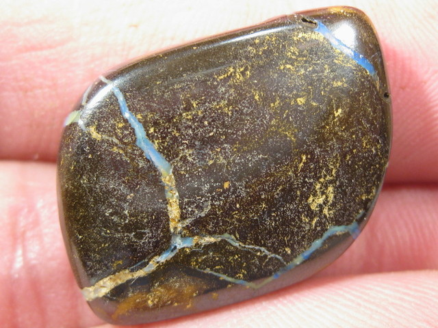 Drilled - Boulder Opal from the harsh Outback of Australia.
