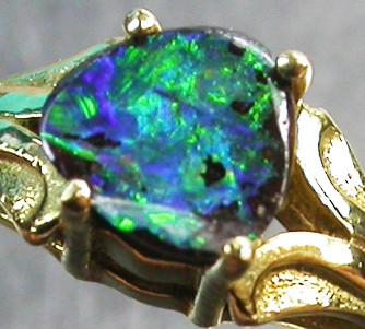 BOULDER OPAL RING SIZE 5   18 K  GOLD   CK 243