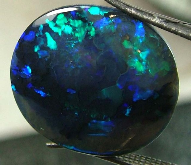 BLACK OPAL POLISHED  L. RIDGE  5CTS  DT-1364