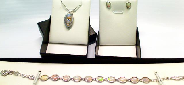 Beautiful set of Light Opal earrings, pendant and bracelet.
