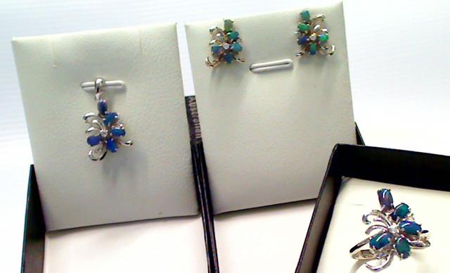 Beautiful set of Black Opal ring, pendant and earrings.