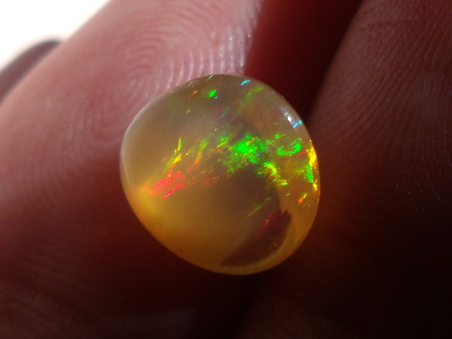 FreeForm carved Fire Mexican Opal 2.45 Carats.