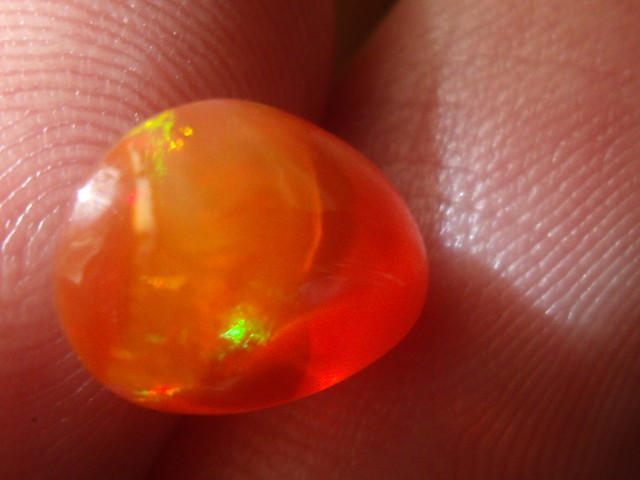 2.59 Cts. FreeForm carved Fire Mexican Opal