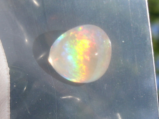 1.79 Cts. FreeForm carved Fire Mexican Opal
