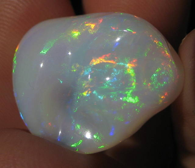 21.66CT HUGE CARVED WELO OPAL WITH BEAUTIFUL FIRE!