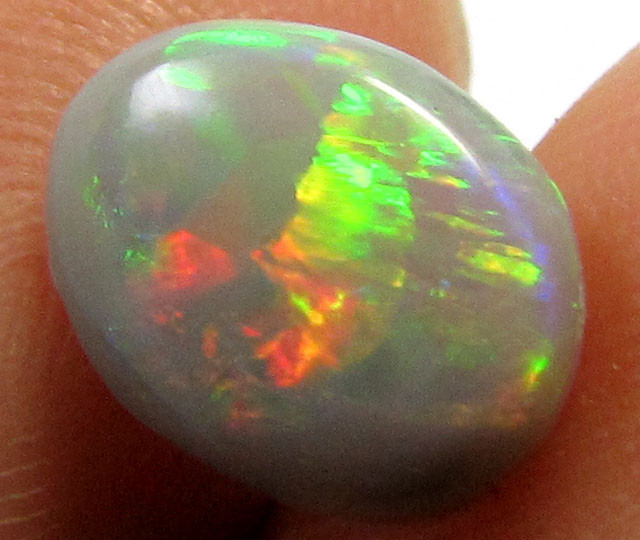 1.25CTS BRIGHT ROLLIGN FLASH  OPAL    PL56