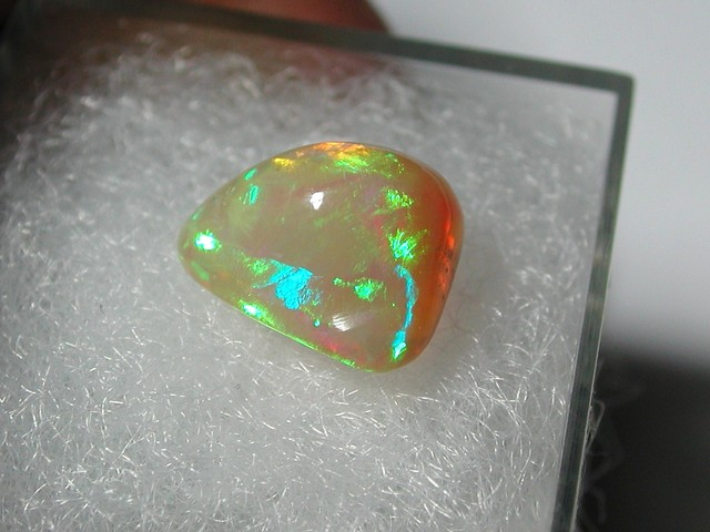 COLOR DANCING ALL OVER THE GEM