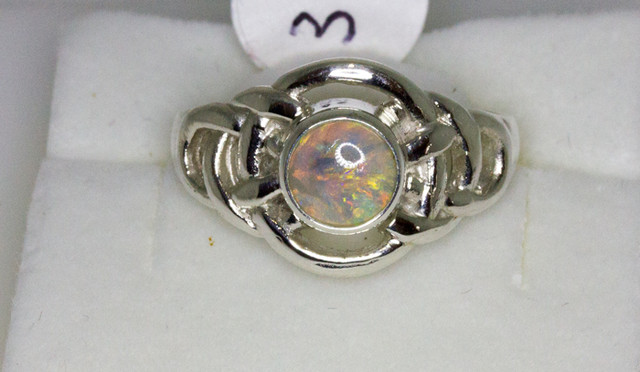 Solid australian Opal set in a S Sliver Ring
