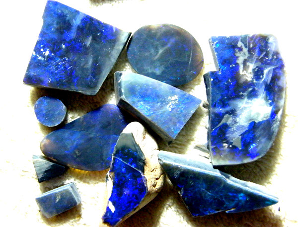 ELECTRIC BLUE BLACK OPAL ROUGH  L. RIDGE  1250  CTS  SAFE