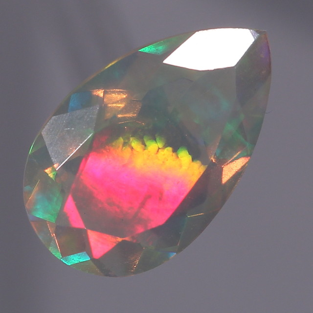 1.61ct. Faceted. VERY Special opal With Metalic Rainbows