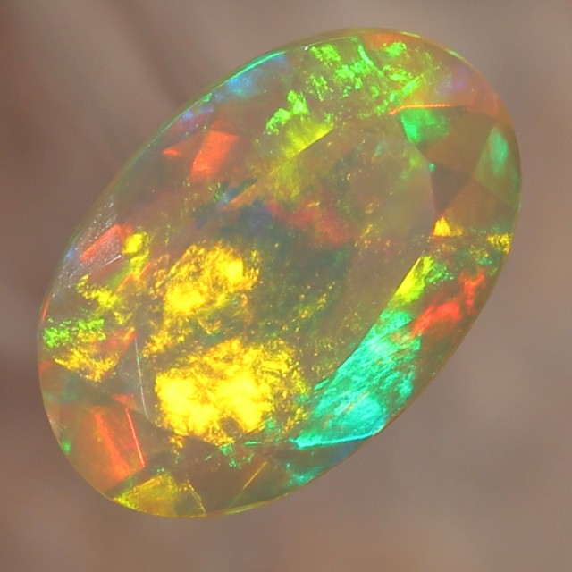 1.92ct. Faceted. Dominant Gold Fire. Big Rolling Flashes