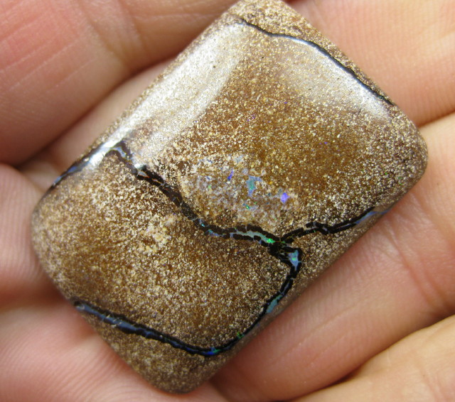 COLOURMINE OPALS>51.70.cts DRILLED PATTERN BOULDER OPAL