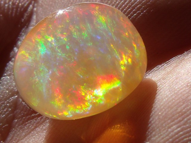 10.13 carats. freeform carved Fire Mexican Opal