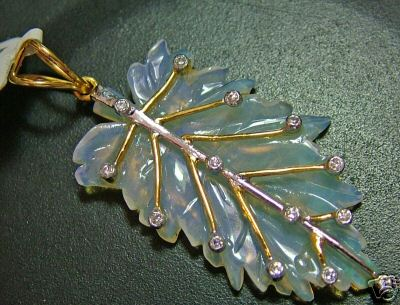 11.7CTS OPAL SOLID CARVED PENDANT 9K GOLD/DIA.