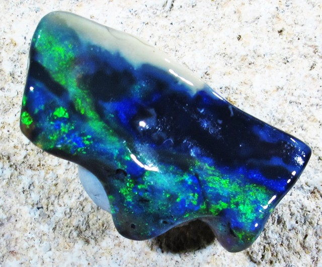 4.87Cts Unique hand polished carved opal   QOM 1470