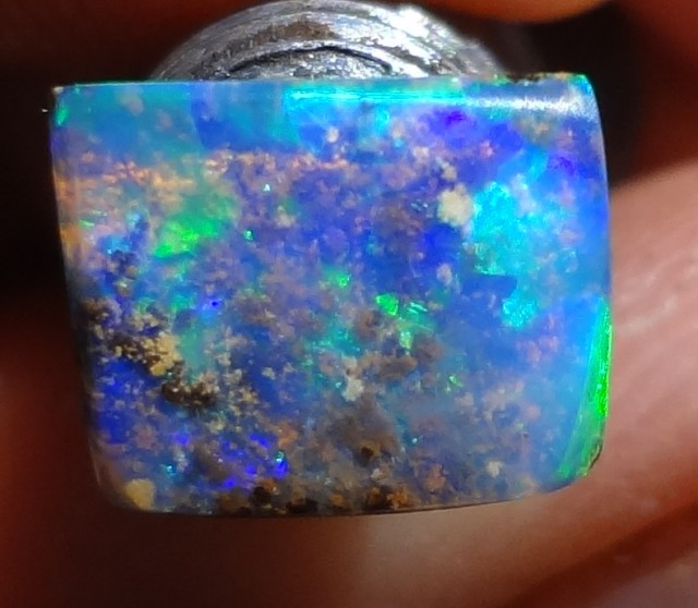 Crystal Boulder Opal with stunning blues and greens. 1.8 carat square