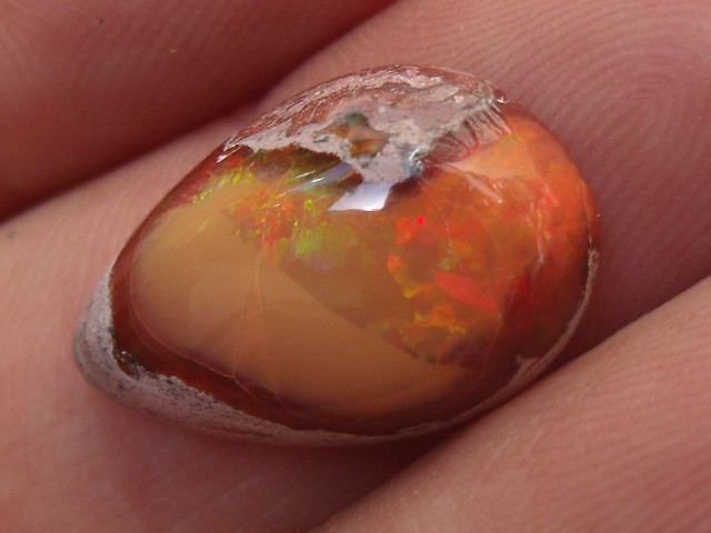 7.89 Carats. FreeForm carved fire Mexican opal