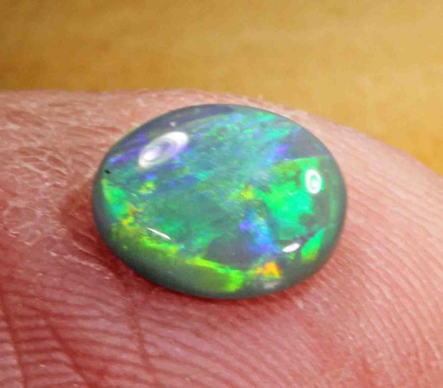1.45 CT  NICE BLACK OPAL FROM LR, VERY BRIGHT