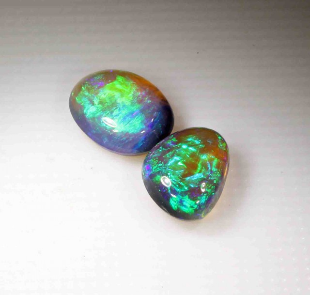 1.45 CT BLACK OPALS X 2  FROM LR