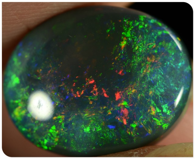 4.40ct Black Opal - ID:20116 Rainbow colour palet Gold/Green colours