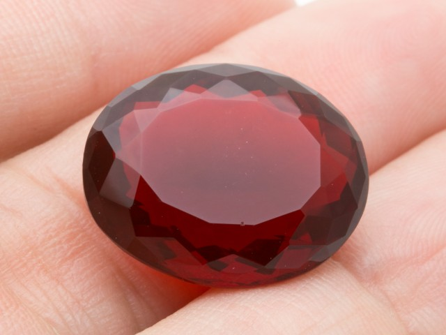14.8ct Faceted Red Oval Mexican Fire Opal (MO205)
