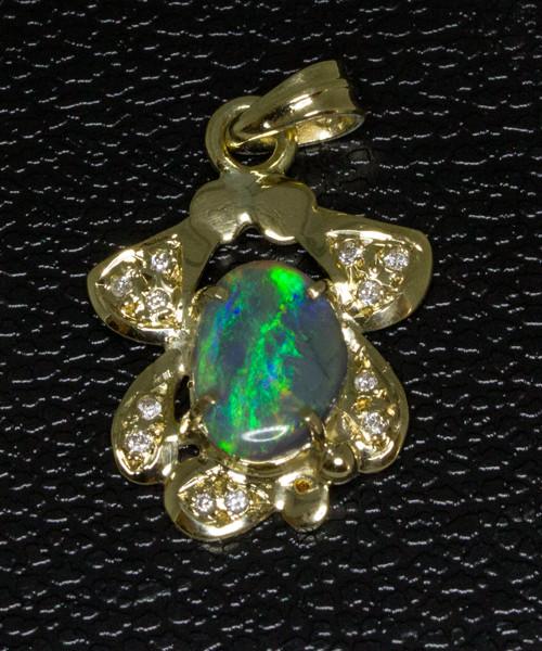 Solid Australian Opal & 12 diamonds set in Gold Pendant