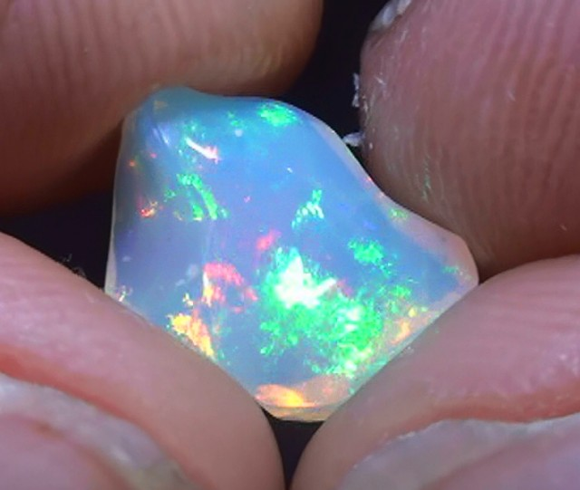 1.95ct Ethiopian Opal Freeform With Very Bright Rolling Color