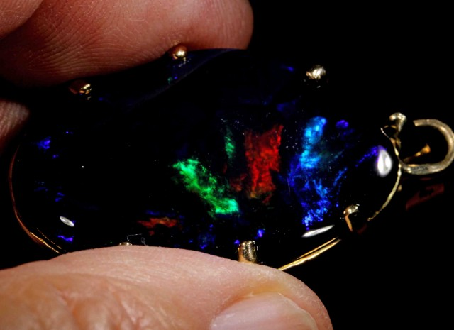 64.95 CTS  BLACK OPAL FROM LR, total weight incl setting