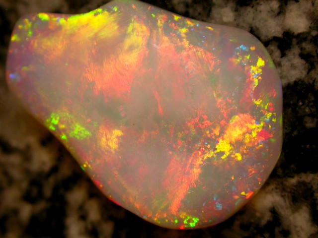 31.25ct HIGHEST QUALITY BIGG ROLLING FLASHFIRE ITS ON FIRE THIS OPAL
